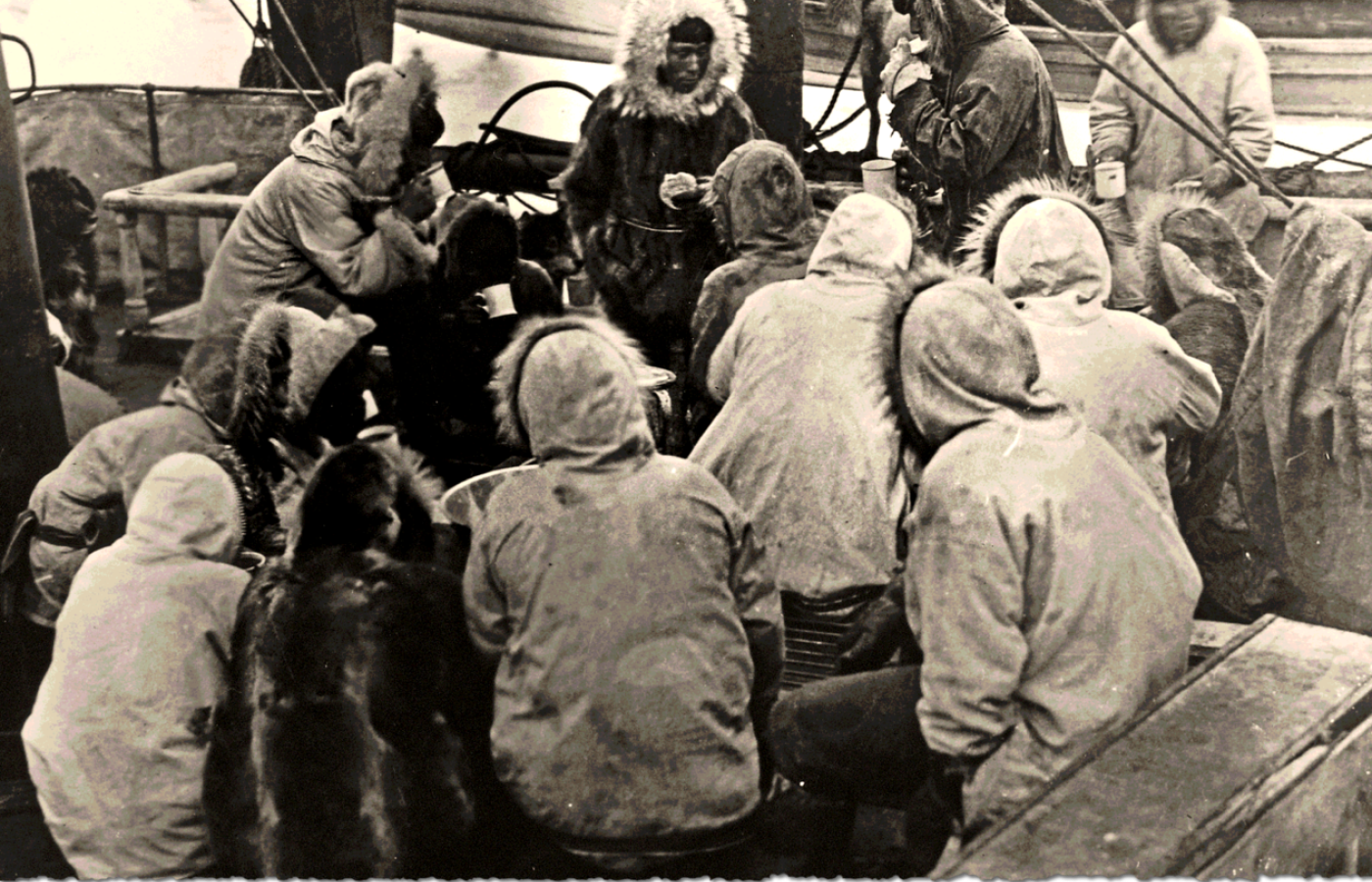 An historical black and white image of Inuvialuit on exploration ship in the early 1900's