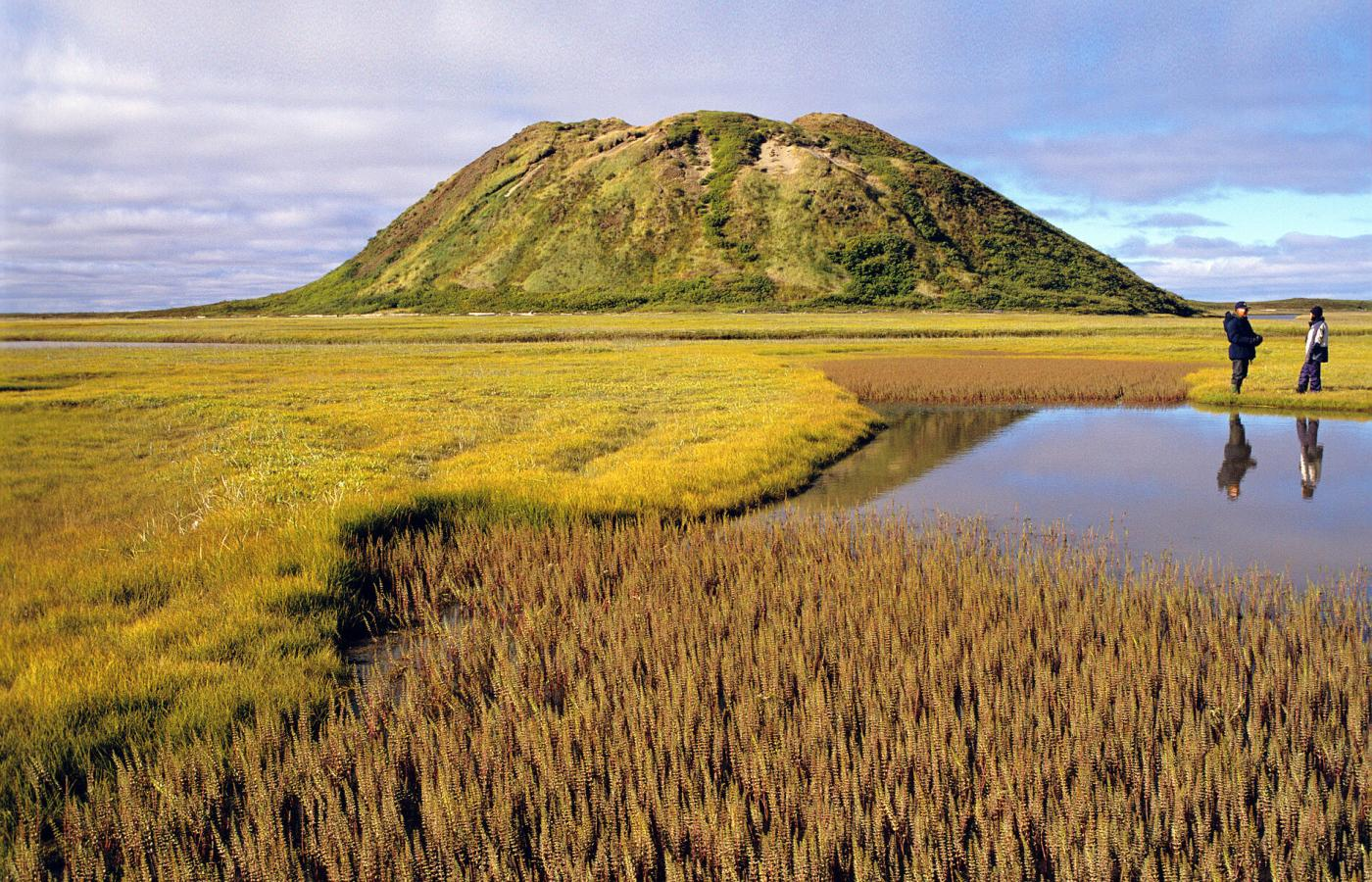 A pingo rises above the tundra landscape of the western Arctic