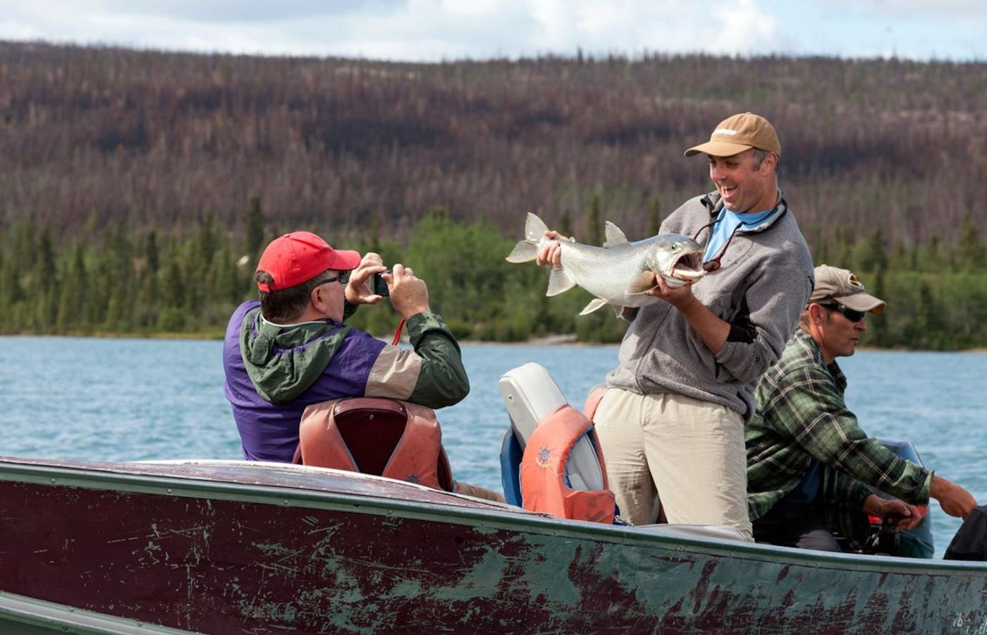 Lake fishing at the lake fishing lodge in the summer catching trout, grayling, pike, arctic char