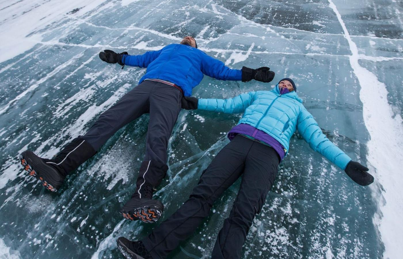 couple posing on ice road