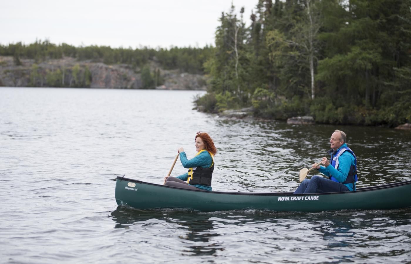 middle aged couple in canoe in yellowknife