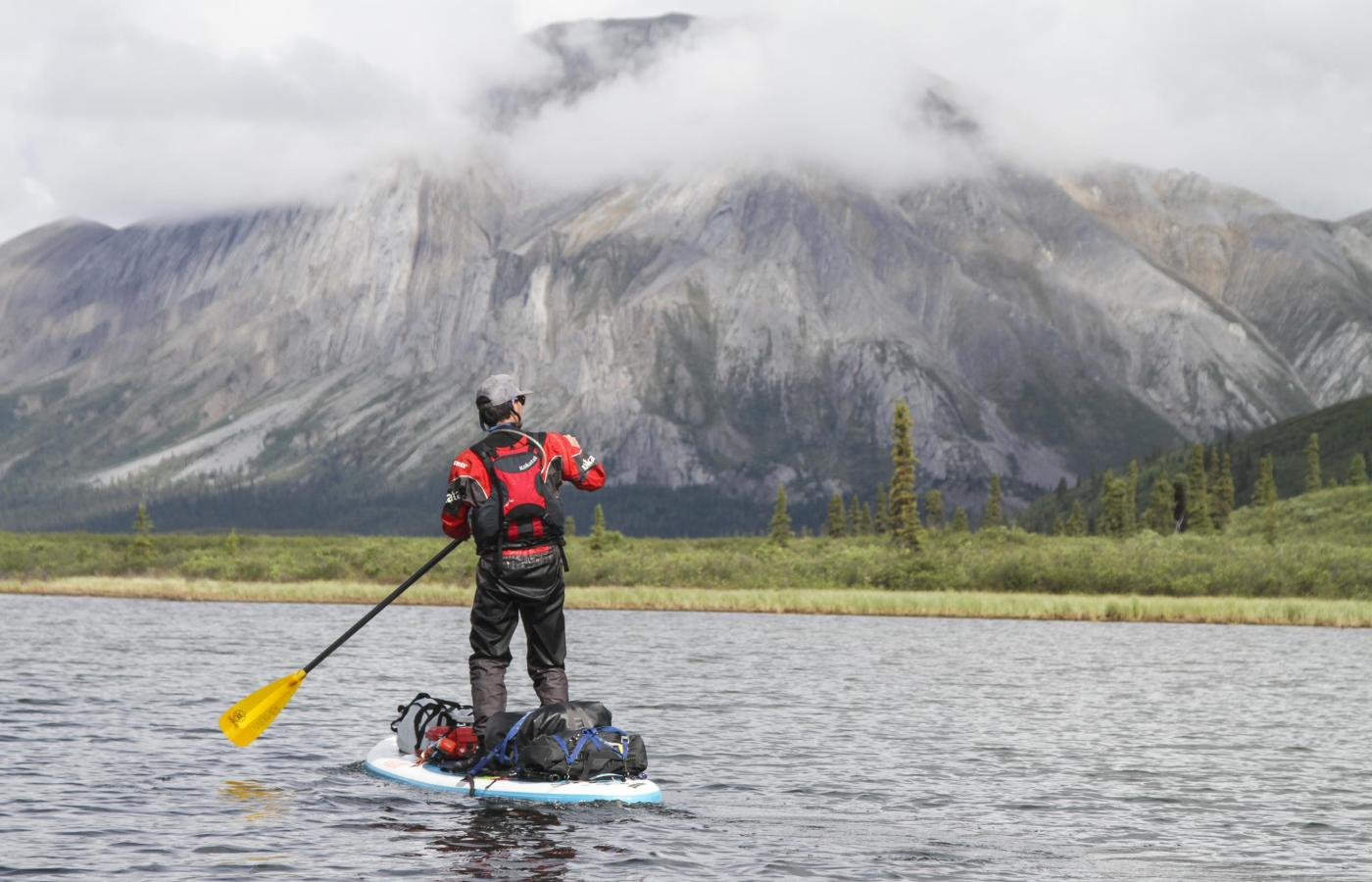 stand up paddling on the mountain river