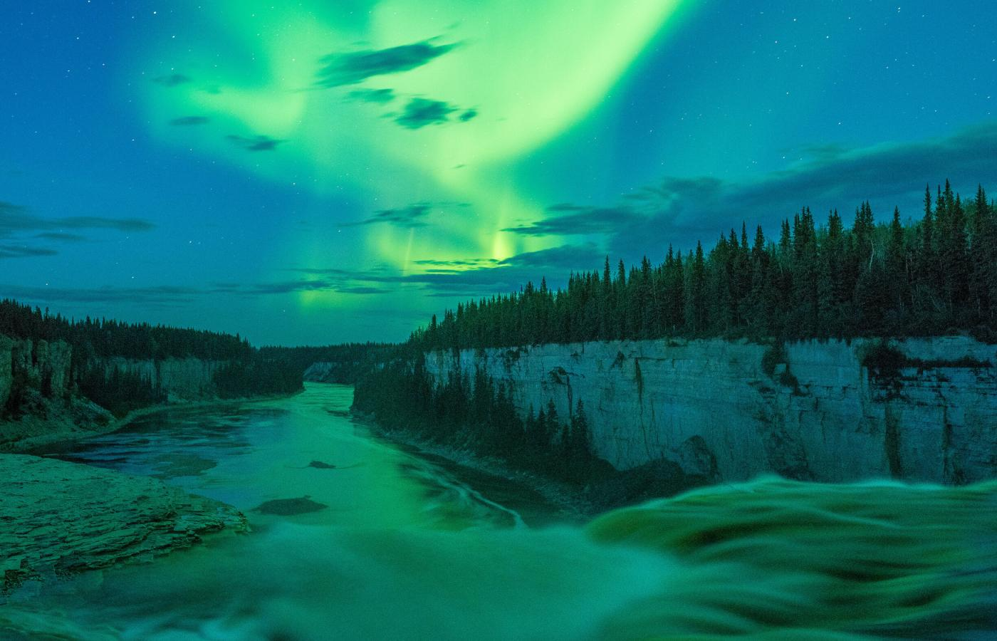 Northern Lights dazzle over Hay River Gorge and Alexandra Falls
