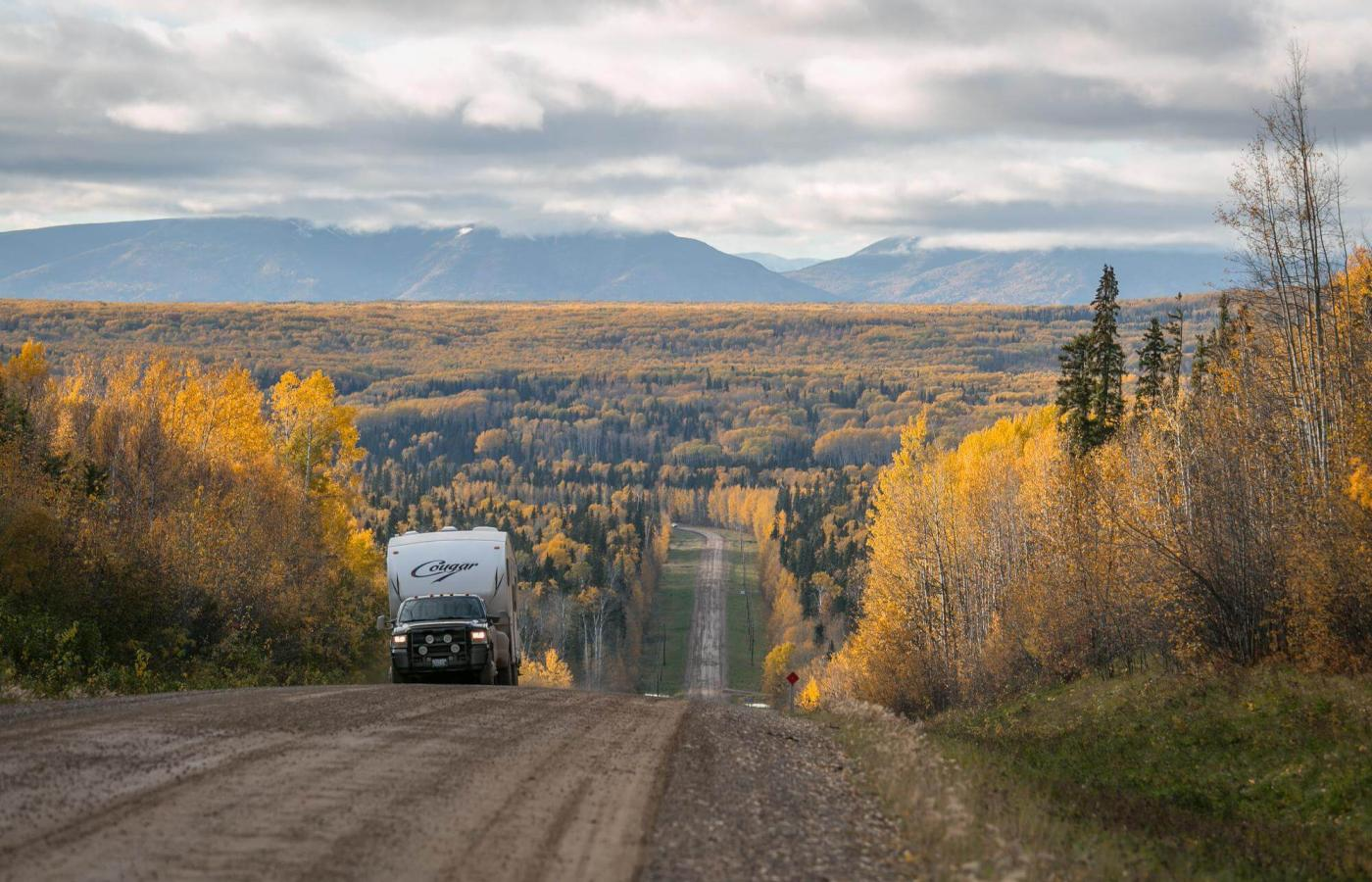 A camper truck travelling a gravel road in the north.