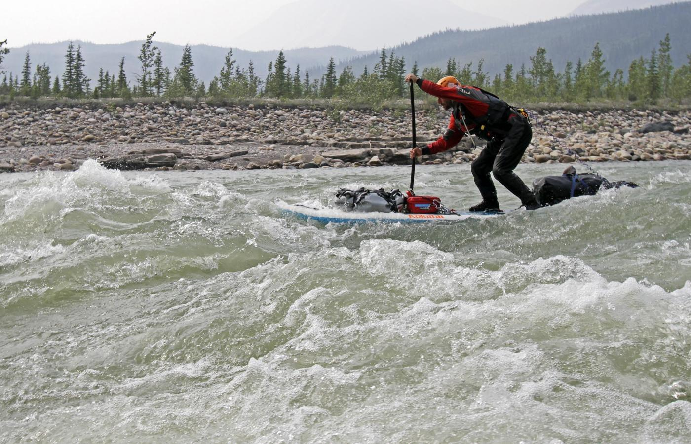 Whitewater paddleboarding on the mountain river