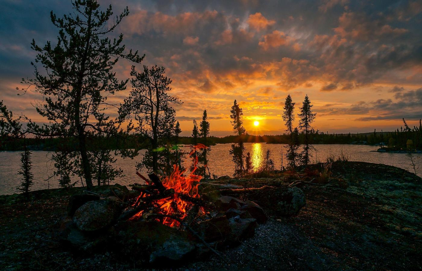 campfire at night with midnight sun