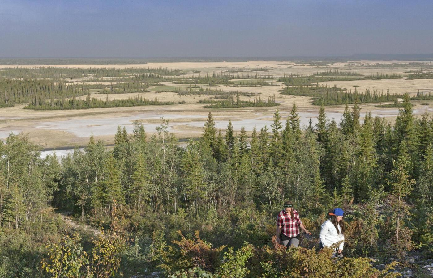 two girls hiking down trail to salt plains in wood buffalo national park