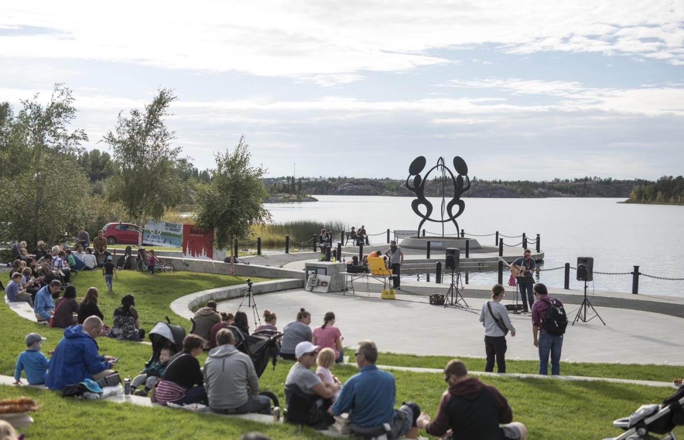 a crowd watches a musician play in Sombe K'e park in Yellowknife