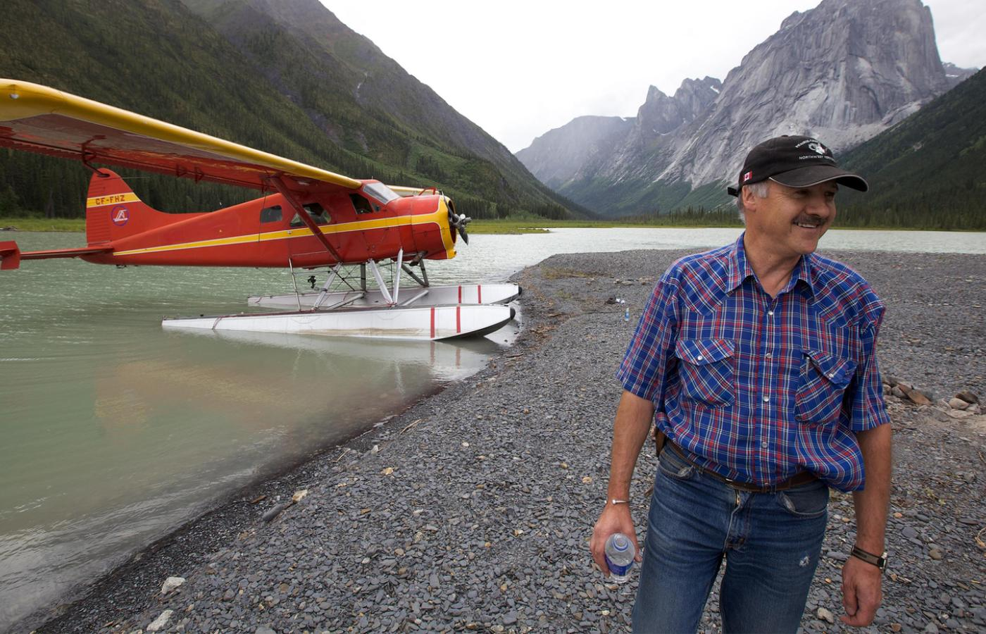 Ted Grant smiling proudly beside his bush plane in Nahanni National Park Reserve