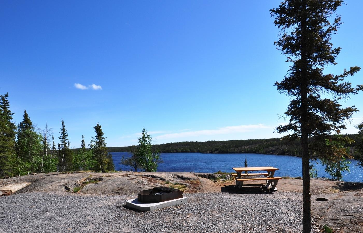 blue sky over a lake-side campsite, minutes outside of Yellowknife
