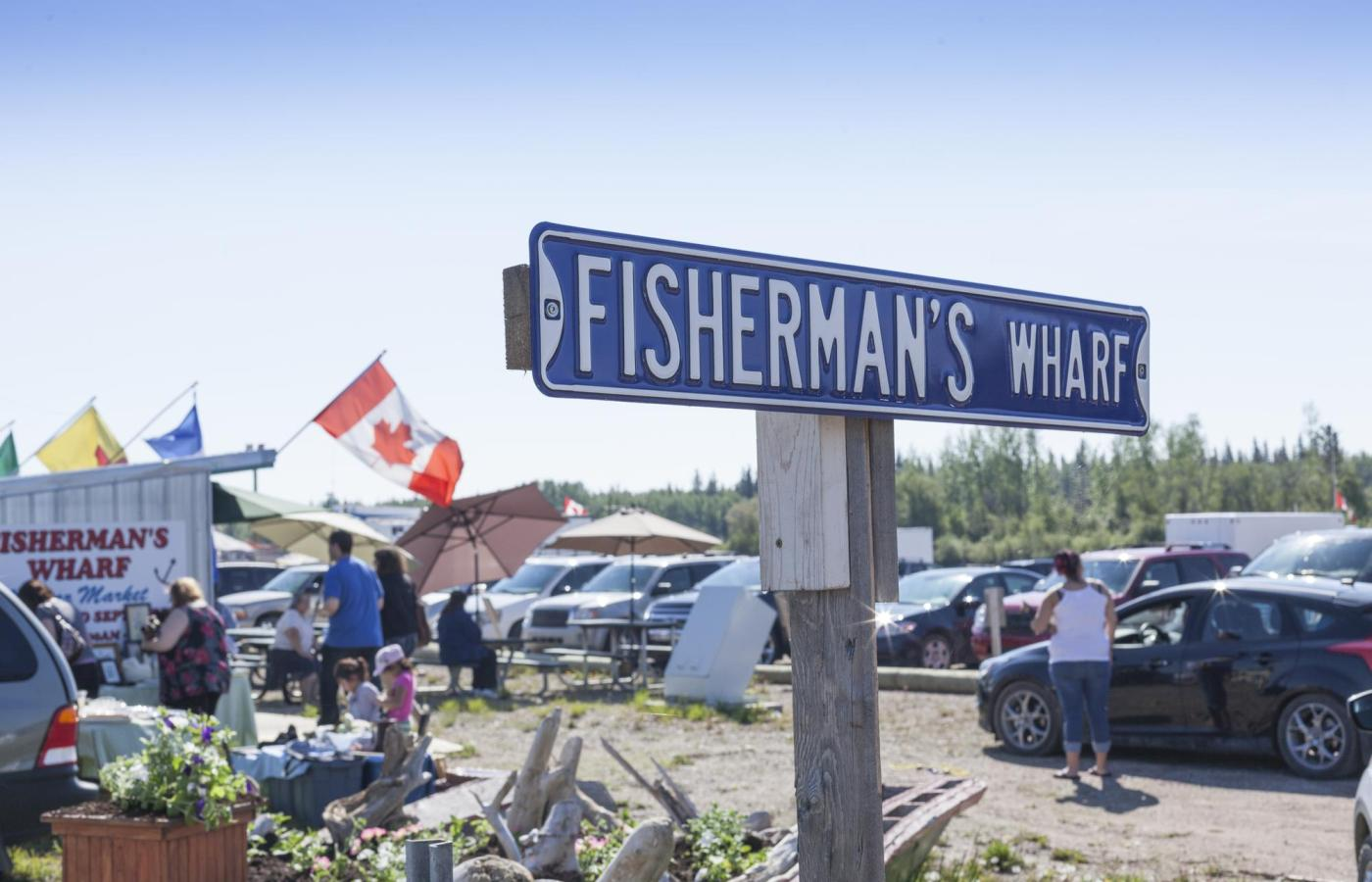 A bustling crowd at the fisherman's wharf in Hay River