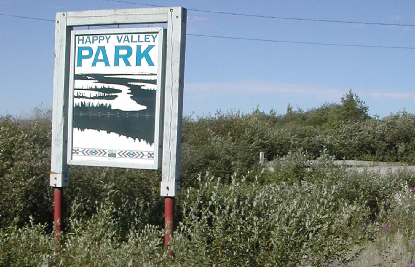 the happy valley territorial park sign in the summer