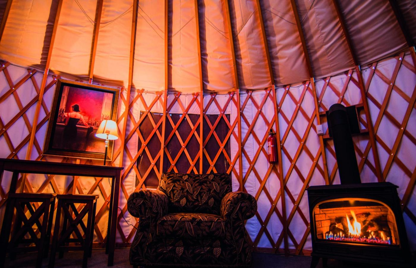 The inside of a Mongolian yurt is illuminated with a warm glow