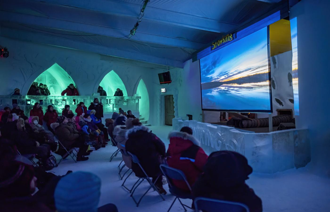 NAKA festival goers watch a documentary in the snowcastle