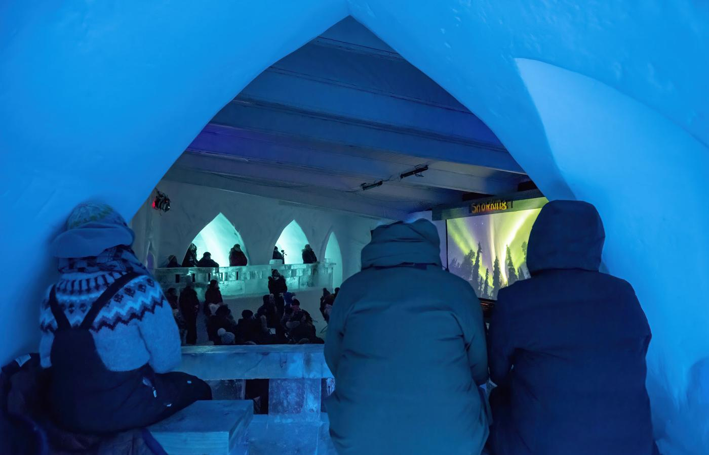 NAKA festival goers peek into the festival happenings at the snowcastle