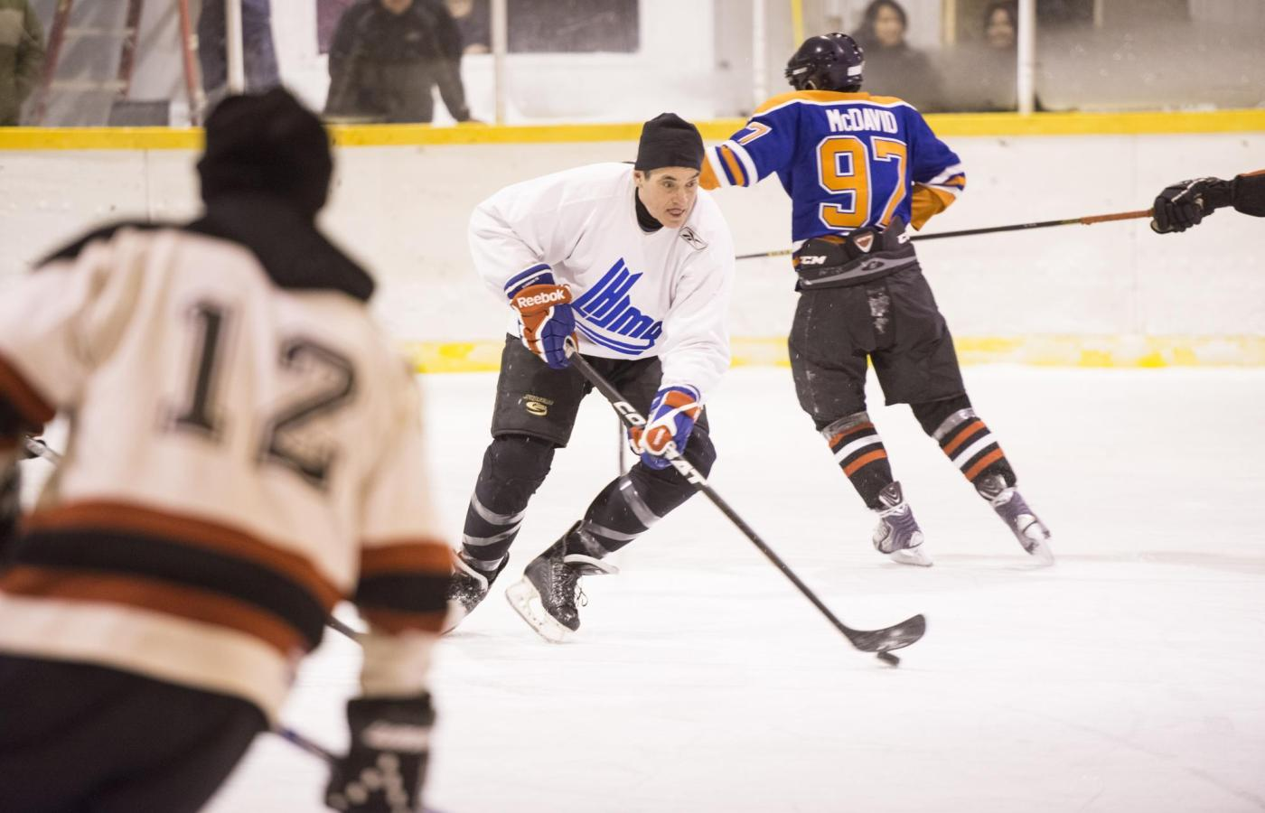 male players playing hockey