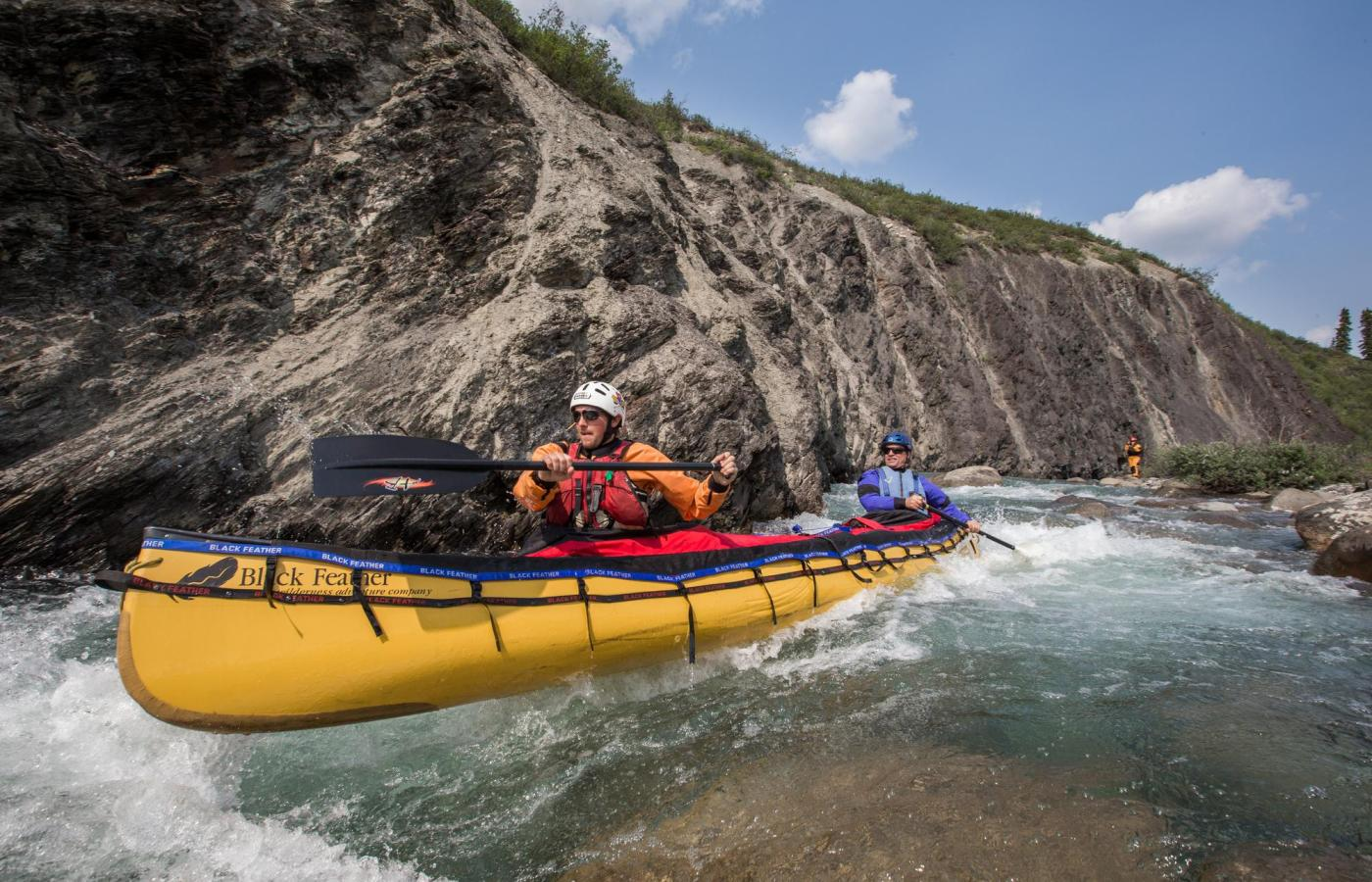 A couple takes on the white water of the nahanni river
