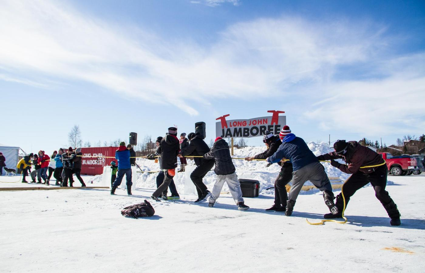 team play tug of war on the ice of the long john jamboree
