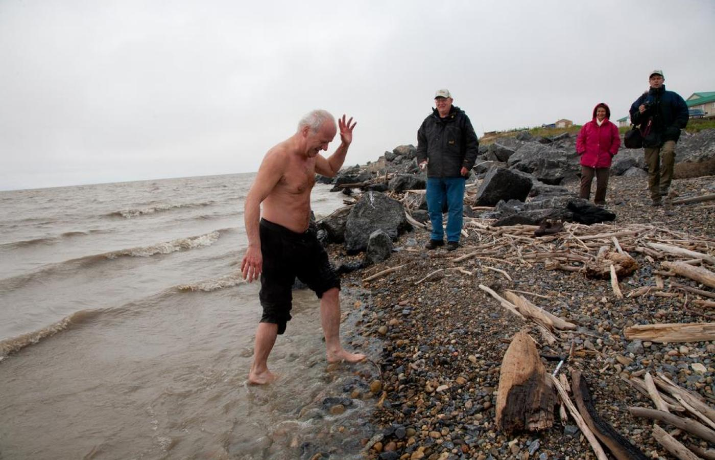 Man taking a short dip in the Arctic Ocean at Tuktoyaktuk