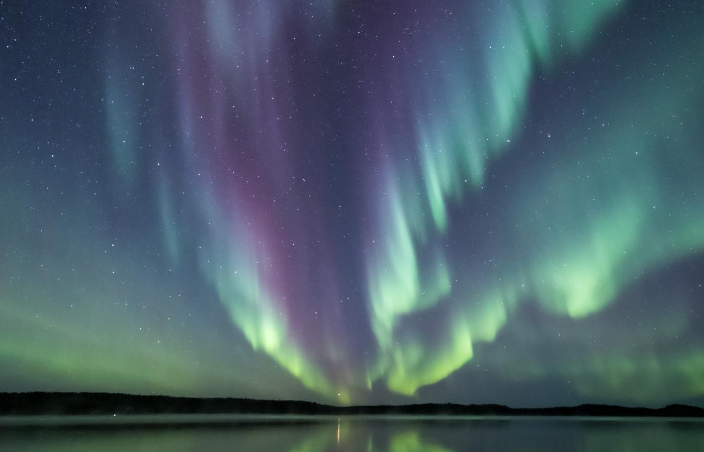 Aurora streaming through the sky over Great Slave Lake in the NWT