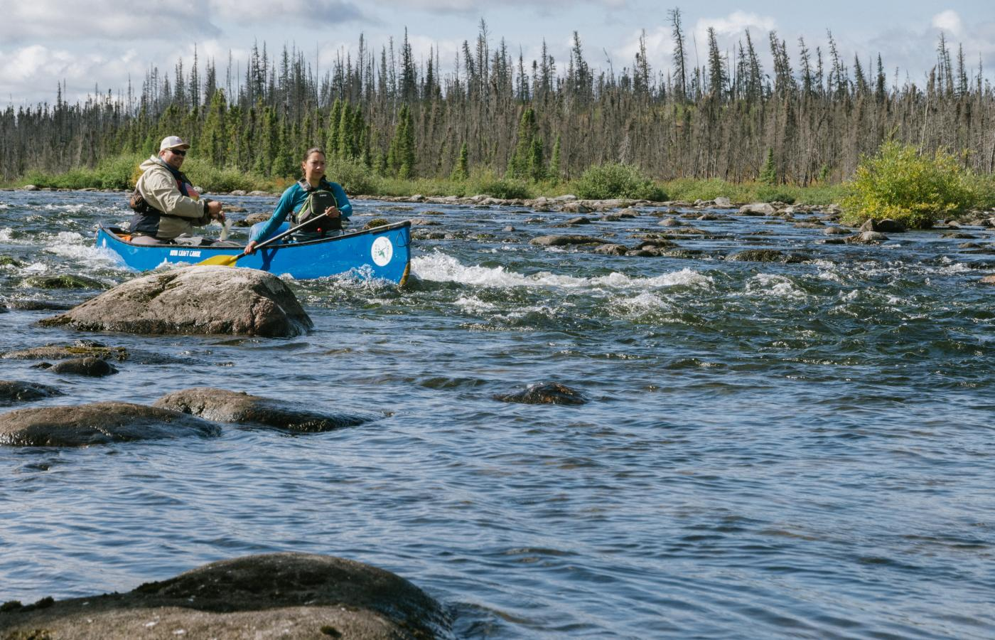 Paddlers on the water in Thaidene Nene
