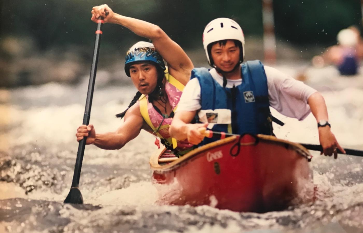 Khoan Pham, Black Feather guide, navigates white water in his canoe