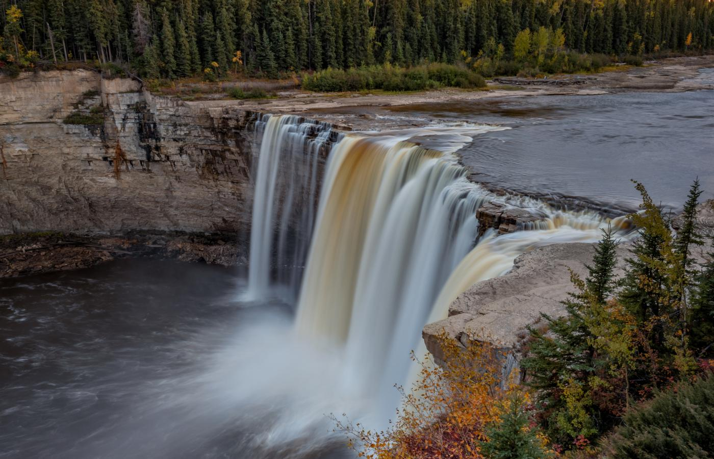 water cascades down Alexandra Waterfalls in the Northwest Territories