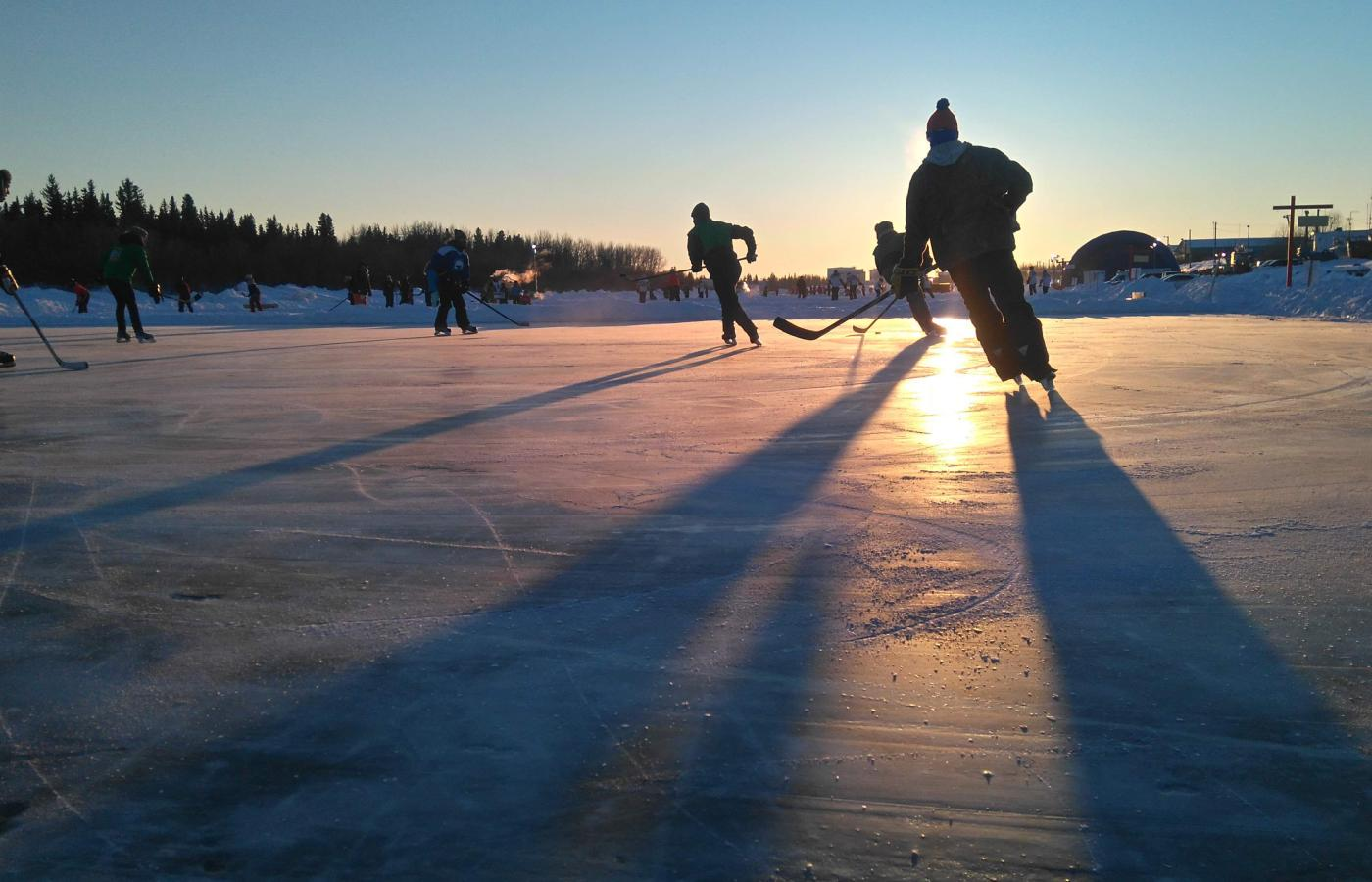 People play hockey on frozen Yellowknife Bay in the Northwest Territories