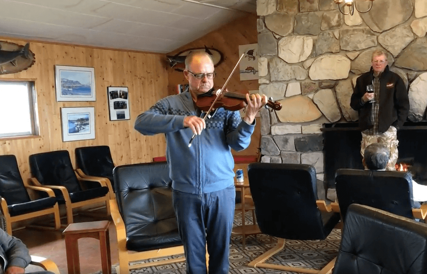 Joe Scheer plays the violin at Plummer's Arctic Lodge, on the Great Bear lake in the Northwest Territories