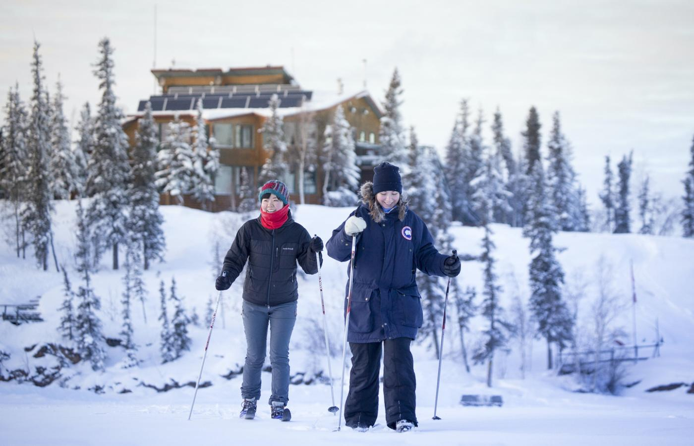 2 people enjoy a snowshoe near Blachford Lake Lodge in the Northwest Territories