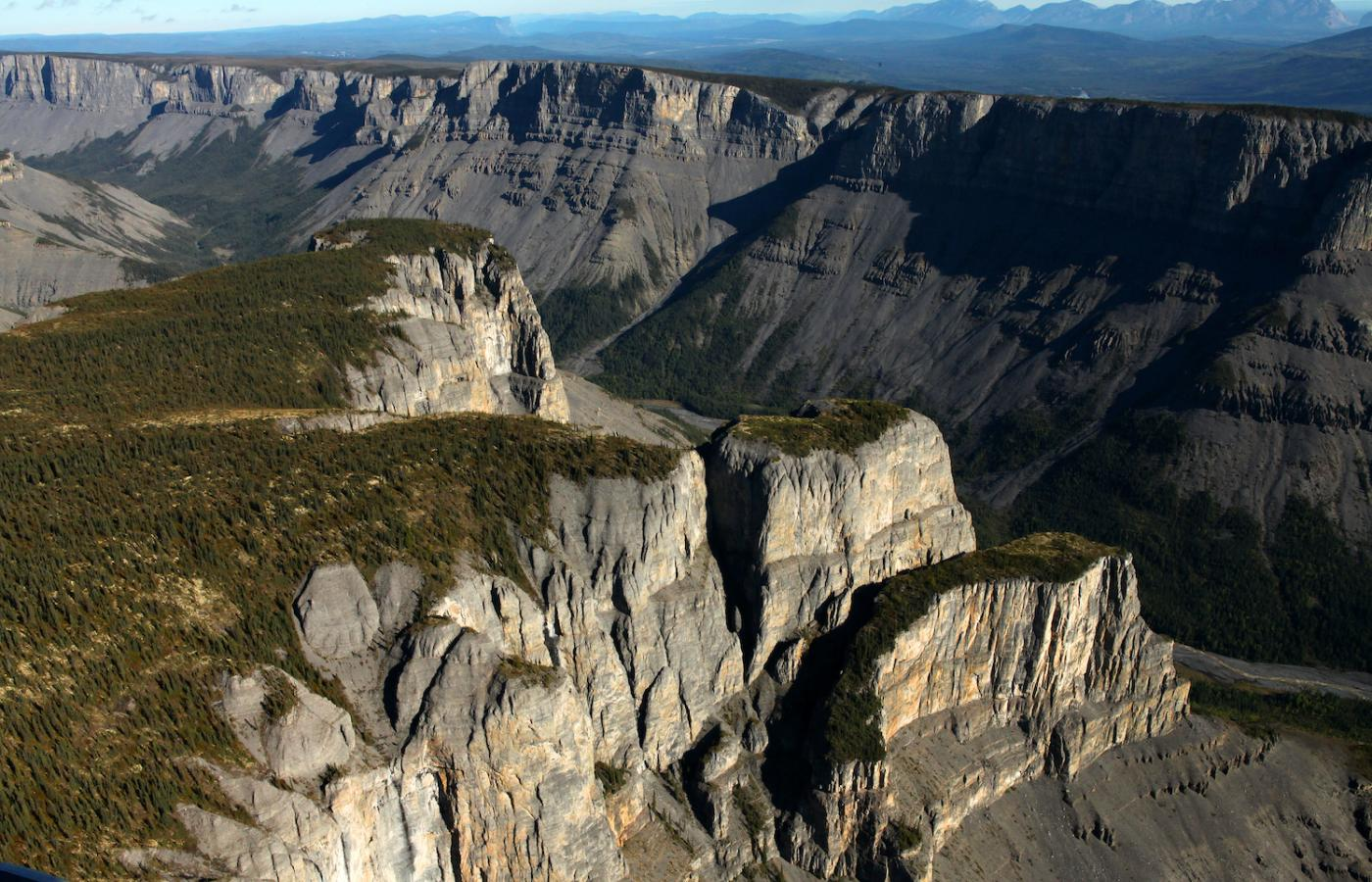 An aerial view of giant cliffs in Nahanni National Park Reserve in the Northwest territories