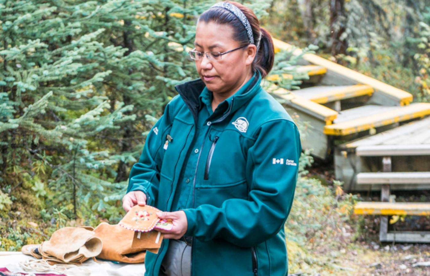 Pauline Campbell an interpreter at Nahanni National Park reserve shows traditional indigenous beadwork in the spectacular Northwest territories