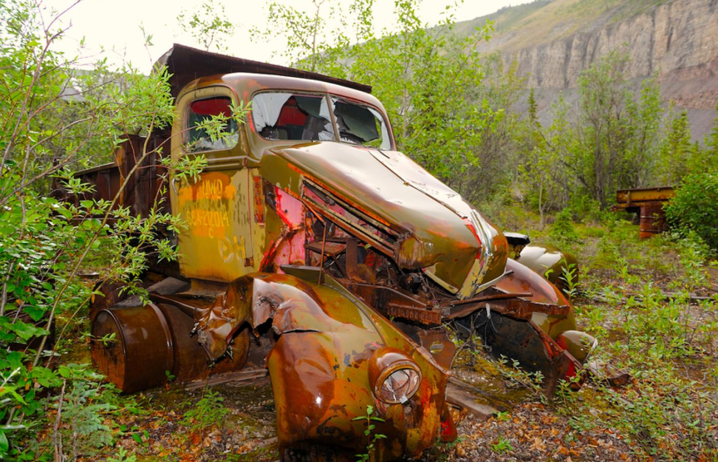 Old trucks from the 1940s line the Canol Trail, in Canada's Northwest Territories, relics from the era the road went in.