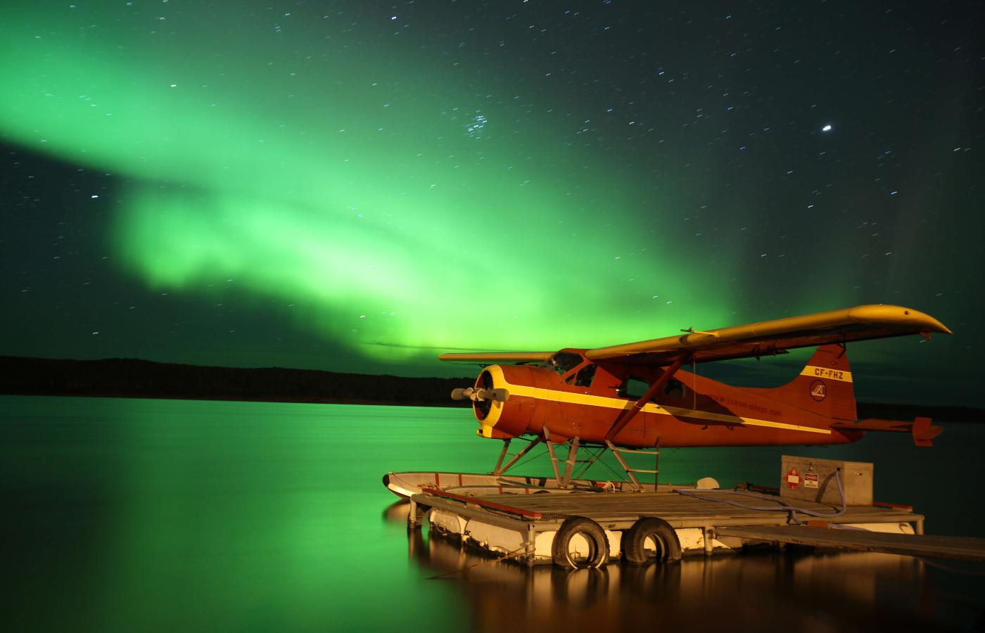Float plane and Northern Lights on the Mackenzie River