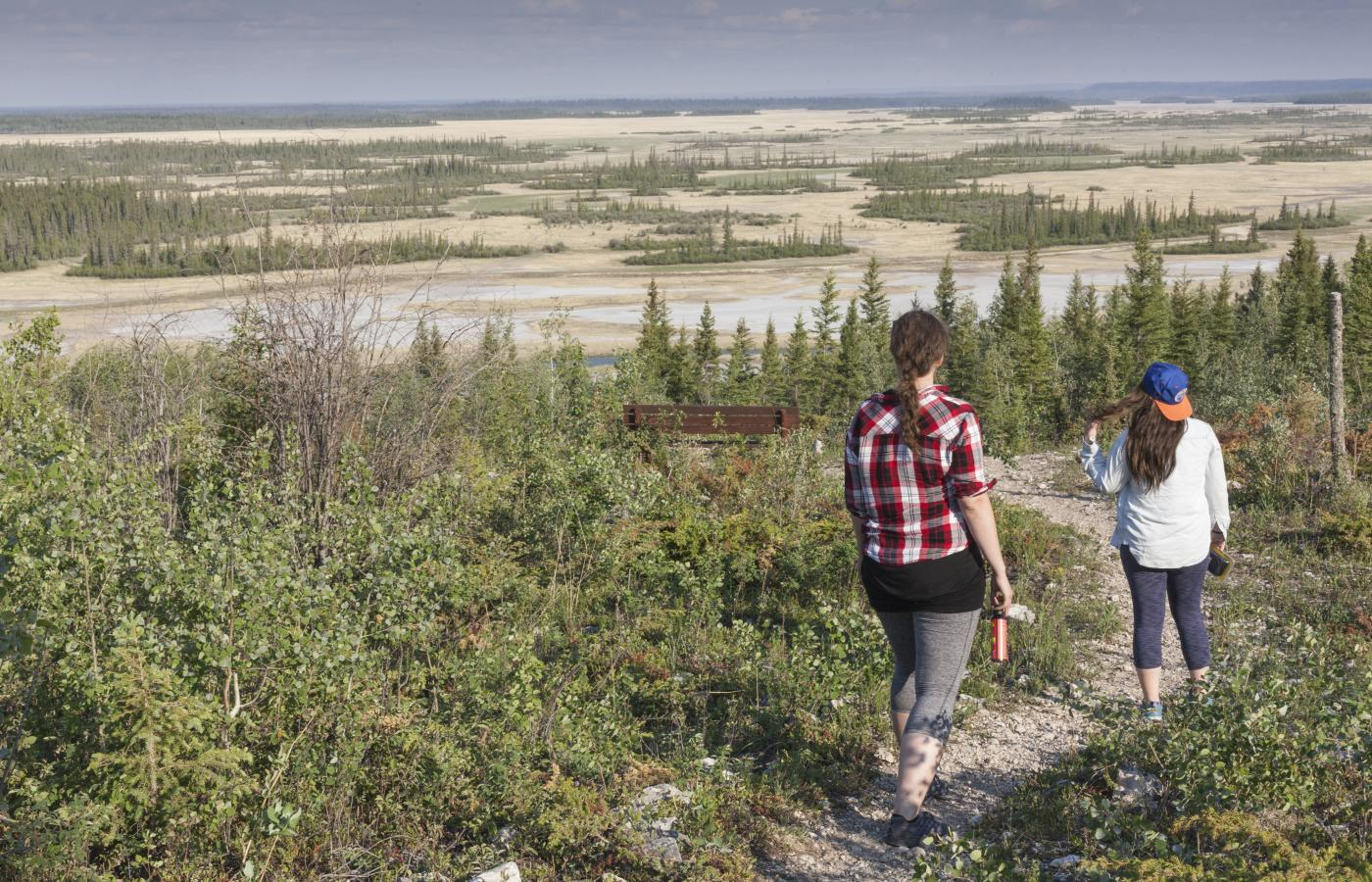 girls walking down the trail to salt plains of wood buffalo national park