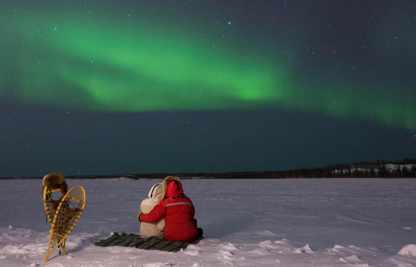 A couple celebrates their love under the Northern Lights in the Northwest Territories