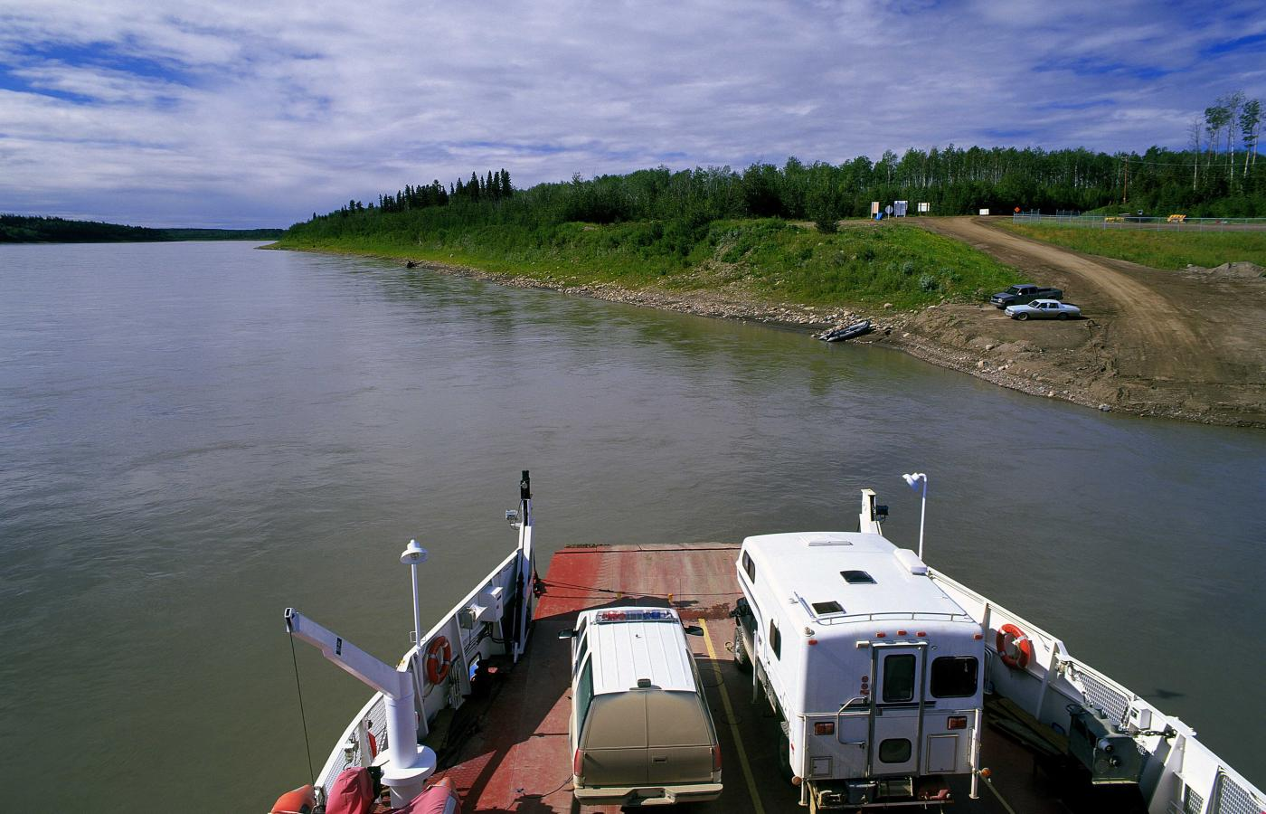 Ferries traverse the Mackenzie River in the Western Arctic region of the NWT