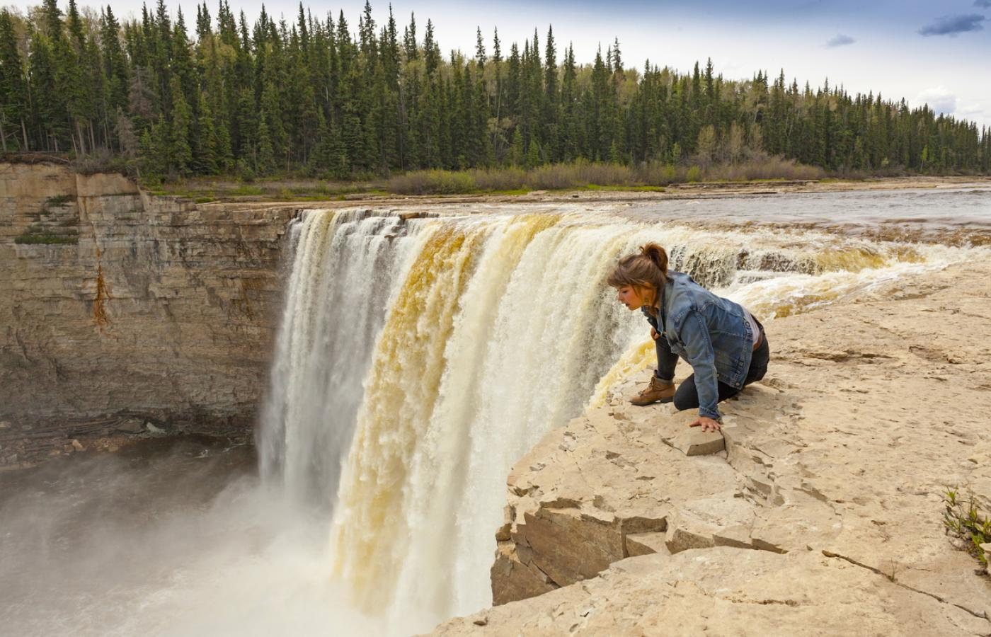 Peeking over the edge of Alexandra Falls in the NWT