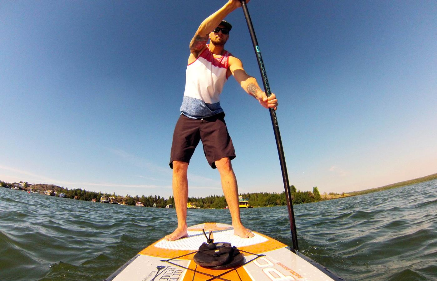 Stand-up paddleboarding outside Yellowknife on Great Slave Lake.
