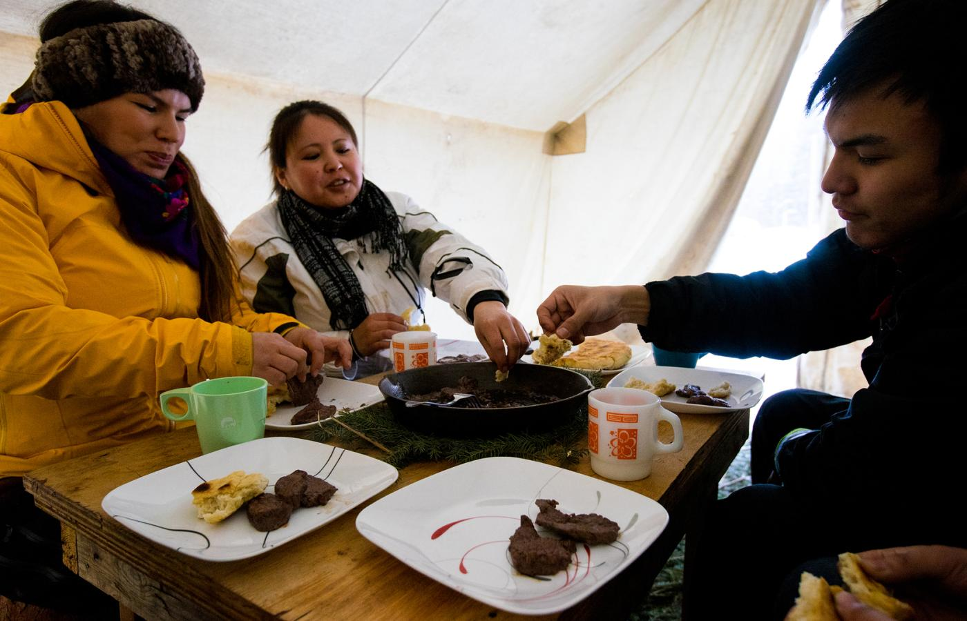 Enjoying a feast in a McPherson tent in the Dehcho