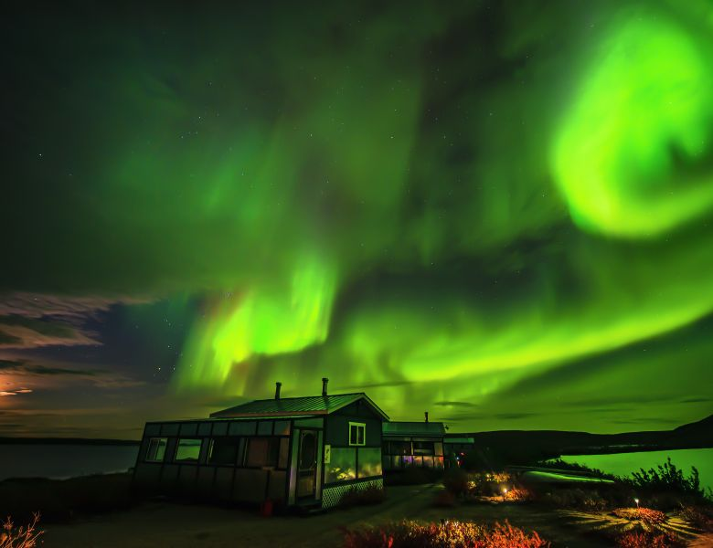 Northern Lights Over Peterson's Point Lake Lodge Guest Cabins