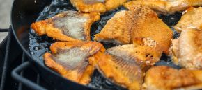 Fish cooked in cast iron pan